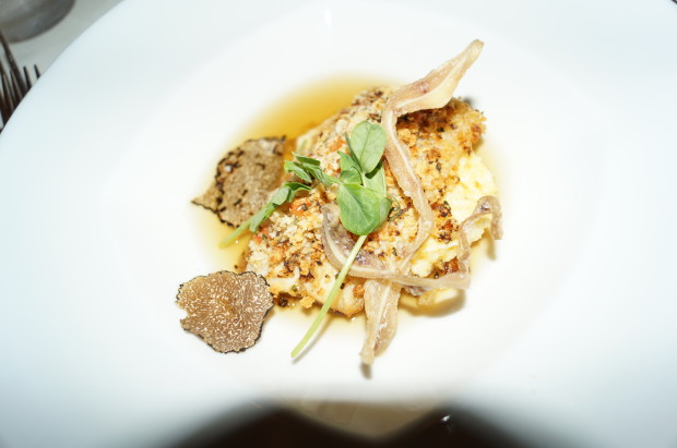 Third course: Hunter-style Branzino, Chicken Consomme, Pig Ear Cracklngs, and Black Truffle