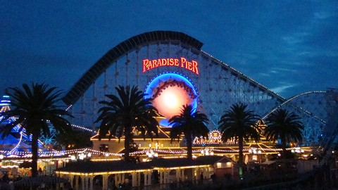 The huge silhouette of California Screamin' dominates Paradise Pier.