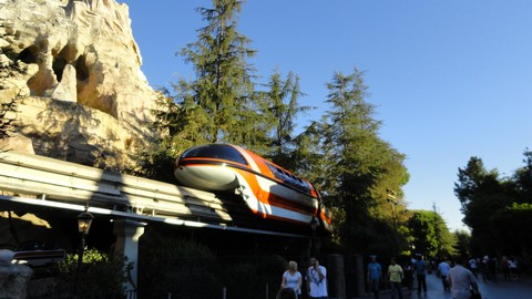 A Disneyland Mark VII monorail rounds the Matterhorn.