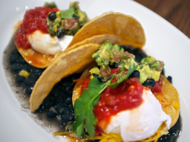 Corn tortillas, poached eggs, jack cheese, and fire-roasted salsa served with avocado-black bean pico de gallo. $9.99