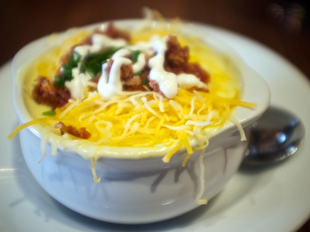 Hearty chili topped with cheese, sour cream, and fresh tomato. $6.99