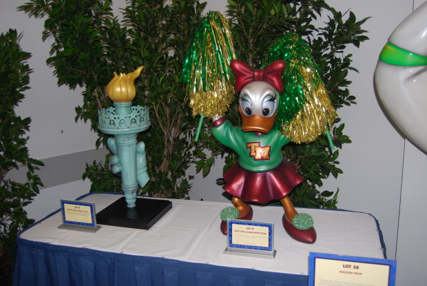 minnies hand holding a torch and daisy duck as a cheerleader  at the d23 expo silent auction