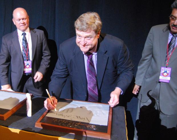 john goodman signing