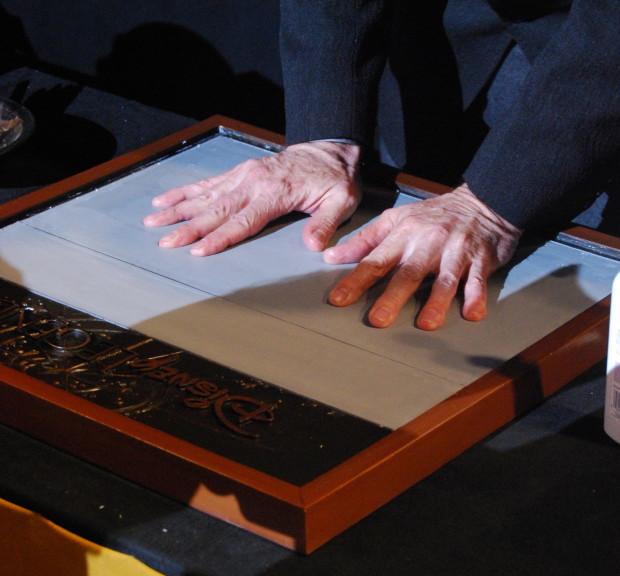 tony baxter hands at disney legends ceremony signing