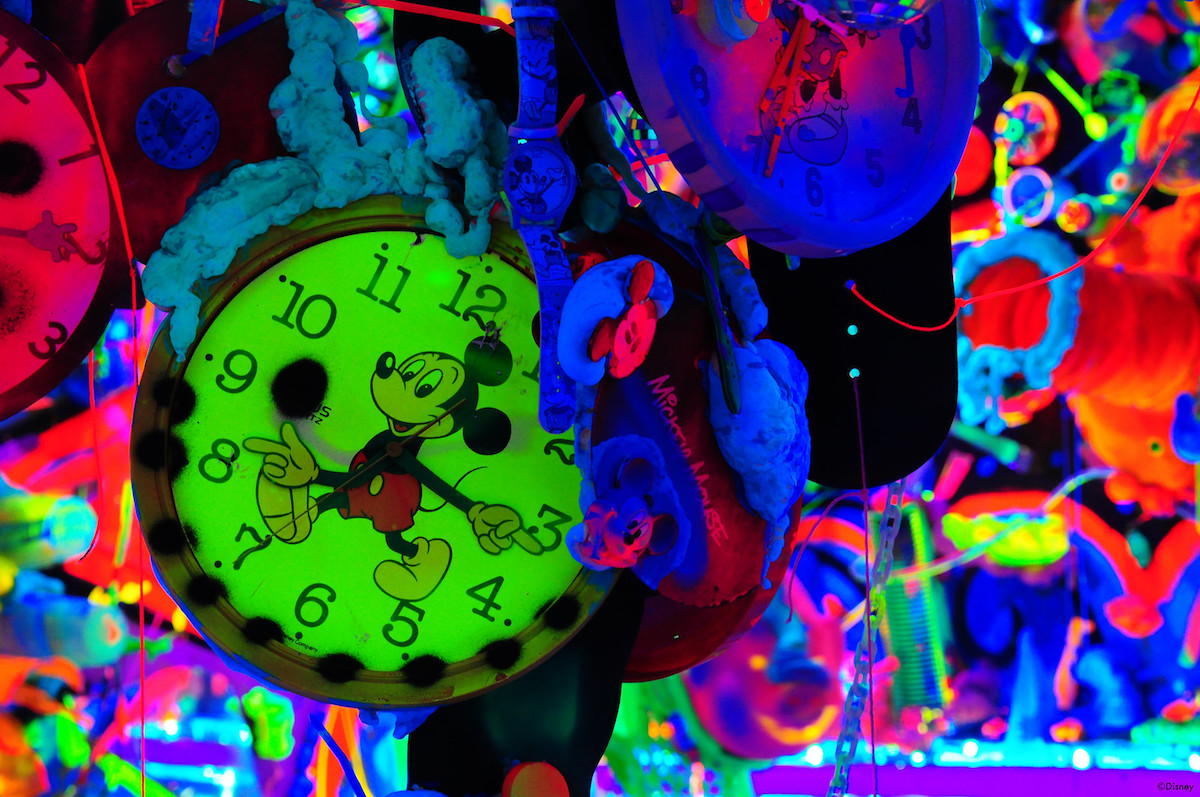 Neon colored background with Mickey Mouse clocks