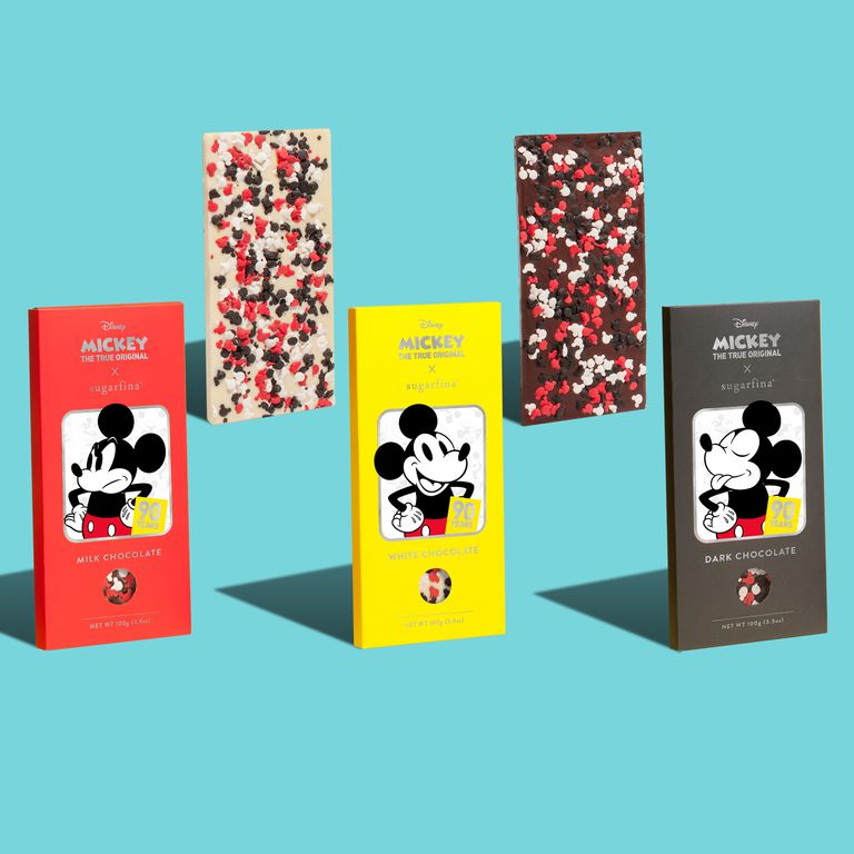 Three Mickey themed candy bars with blue background