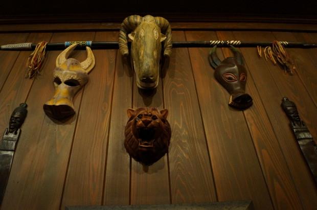 club 33 trophy room masks on wall