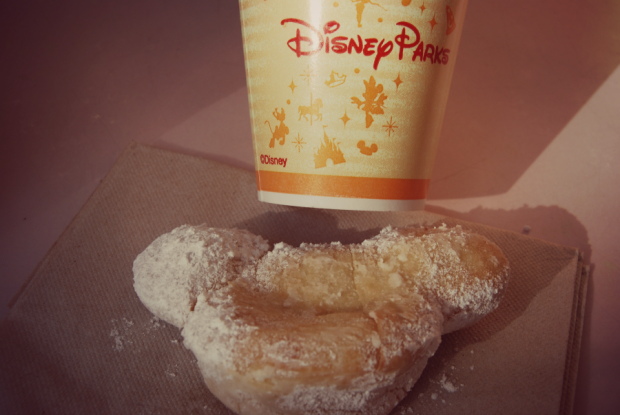 disneyland mickey mouse beignet at the mint julep bar in new orleans square