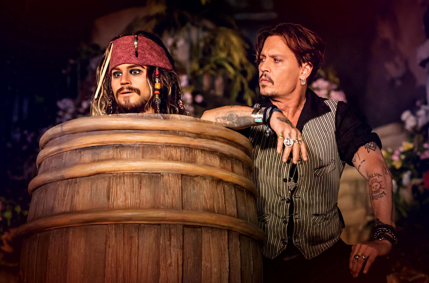 Johnny Depp staring at his attraction rendering of Jack Sparrow