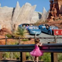 Cars Land with small girl watching cars