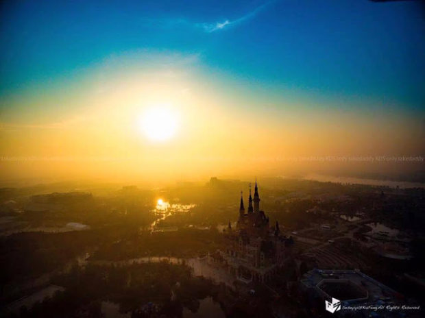 shanghai disneyland castle sunset